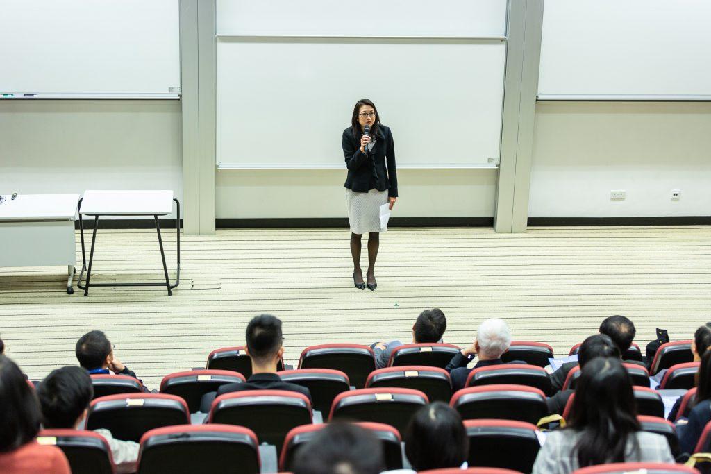 Asian woman giving speech