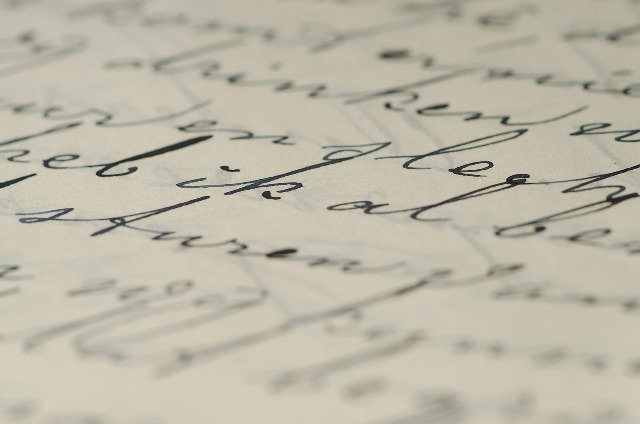 Close up college essay handwritten letter cursive ivy league