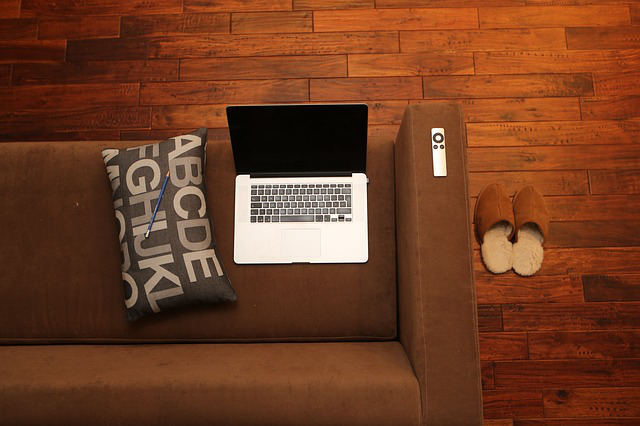 Living room sofa with laptop and slippers
