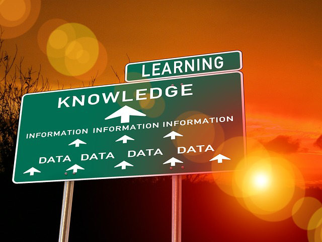Traffic sign pointing towards learning knowledge data information