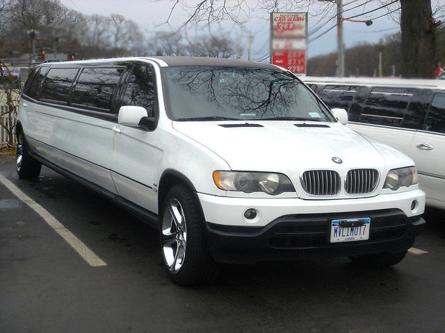 white BMW X5 Stretch Limo parked