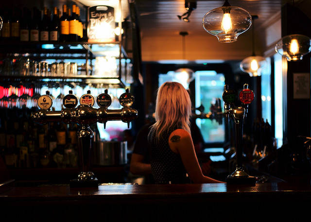 Bartender job beer on tap bar dark pub London Mayfair District