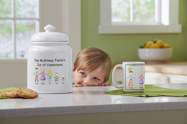 Personal Creations little kid peeking at personalized cookie jar and personalized mug on counter