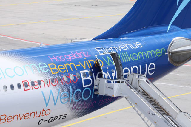 Airplane with welcome in different languages on it