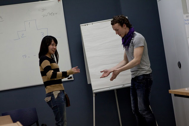 Two people at a language teaching workshop