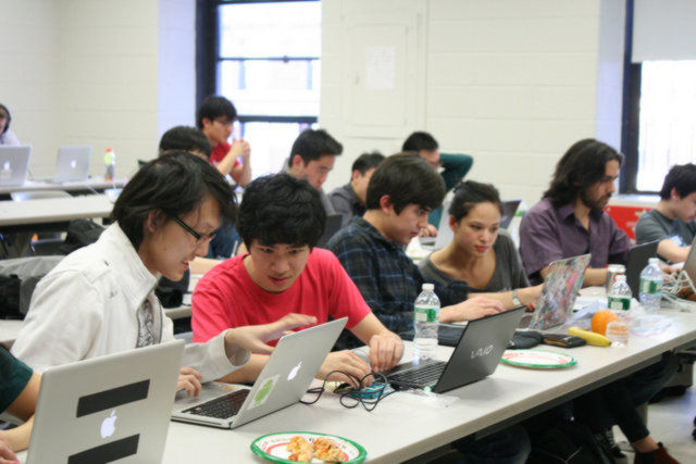 Students working together at Columbia university hackathon 2013