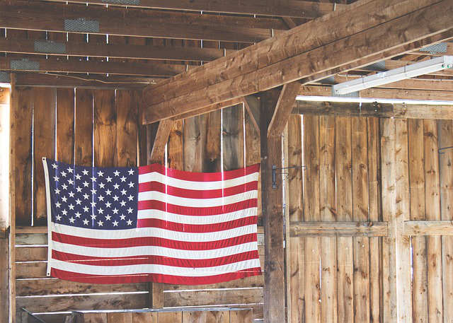 American Flag Hanging from Wooden Wall